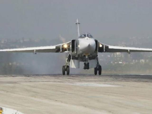 A Sukhoi Su-24 fighter jet lands at the Hmeymim air base near Latakia, Syria, in this handout photograph released by Russia's Defence Ministry November 7, 2015. PHOTO: REUTERS