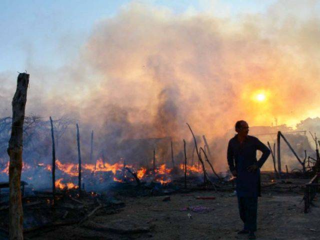 In this file photo, a man surveys the damage caused by the blaze that destroyed a dozen shanties in Karachi. PHOTO: MOHAMMAD NOMAN/EXPRESS