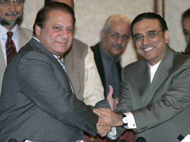 Asif Ali Zardari, right, widower of Benazir Bhutto and co-chairman of Pakistan Peoples Party, shakes hands with Nawaz Sharif during a press conference in Bhurban near Islamabad, March 9, 2008. — Photo by AP