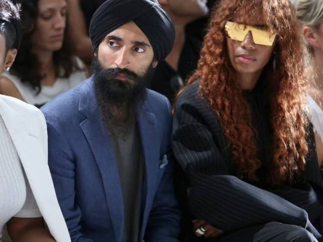 Actor Waris Ahluwalia (left) and Santigold attend DKNY Women's Spring 2016 during New York Fashion Week. PHOTO: AFP
