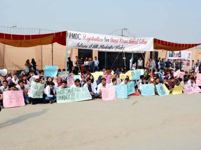 Students protesting in front of the college. PHOTO: EXPRESS