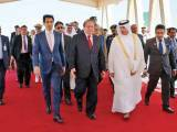 PM Nawaz being received by his Qatari counterpart at Doha airport. PHOTO: PPI