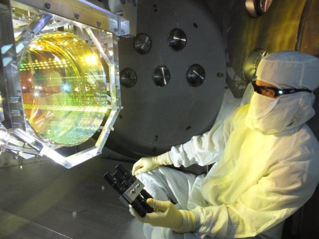 This image, taken December 14, 2015, shows a Laser Interferometer Gravitational Wave Observatory (LIGO) optics technician inspecting one of LIGO's core optics (mirrors). PHOTO: AFP