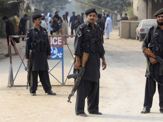 A file photo of Peshawar police. PHOTO: REUTERS