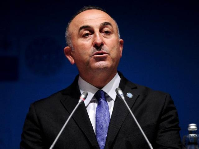 Turkish Foreign Minister Mevlut Cavusoglu speaks during a press conference on May 12, 2015 in Antalya on the eve of meetings of NATO Ministers of Foreign Affairs. PHOTO: AFP