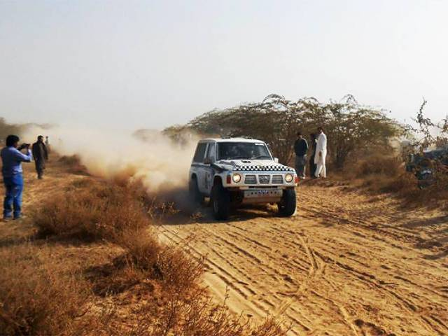 Jeep passing by spectators during 11th  Cholistan TDCP Jeep Rally. PHOTO: ONLINE