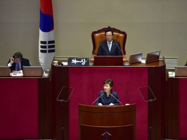 "South Korean President Park Geun-Hye (C bottom) delivers a speech at the National Assembly in Seoul on February 16, 2016. Park called for ""courage"" in standing up to North Korea, saying a fundamentally new approach was needed to derail Pyongyang's nuclear weapons program. PHOTO: AFP"