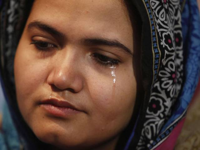 In this photo taken on Jan. 26, 2016, Kainaat Soomro weeps during an interview with The Associated Press in Karachi, Pakistan. PHOTO: AP