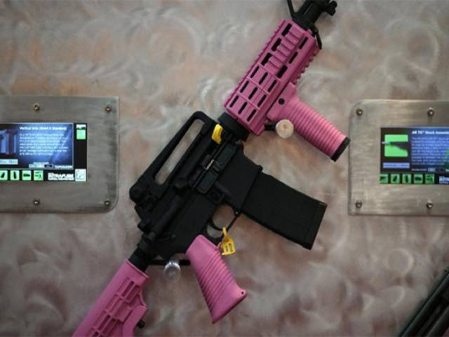 An assault rifle with pink highlights is displayed during a National Rifle Association annual Meeting in Houston, Texas. PHOTO: AFP