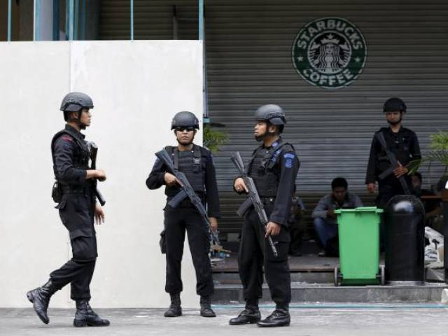 Indonesian police stand guard at the site of a militant attack in central Jakarta, Indonesia in this January 16, 2016 file photo. PHOTO: REUTERS
