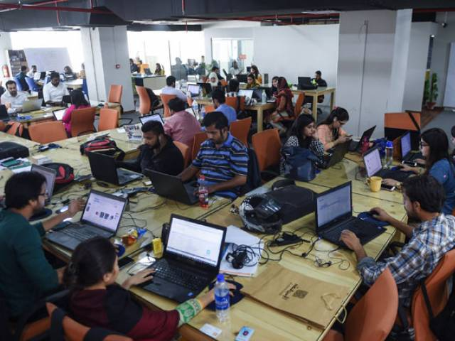 "This photograph taken on November 19, 2015 shows Pakistani employees of online marketplace company Kaymu at work in Karachi. Women are seeing the benefits, but e-commerce presents potentially an even greater opportunity for young people in a country where roughly two thirds of the population -- of around 200 million -- are estimated to be under the age of 30. A recent economic survey by the finance ministry singled out the challenges facing youth in Pakistan, including ""limited job search expertise, a mismatch between education, aspirations and employers' requirements and a lack of mobility, among other factors"". PHOTO: AFP"