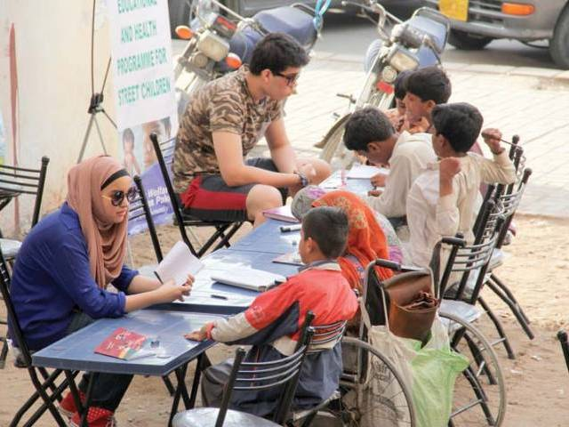 Shireen and Hassan teach street children at an empty plot near Cafe Clifton six days a week from 4:30pm to 6pm. PHOTO: AYESHA MIR/EXPRESS