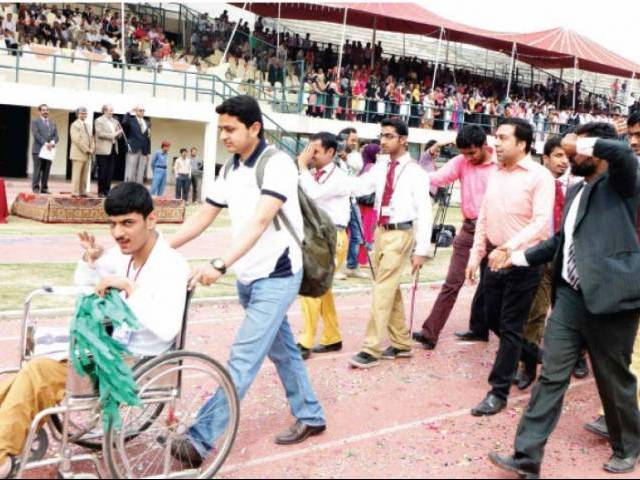 Physically-challenged students of GCU Lahore participate in the inaugural ceremony of 116th annual sports on Wednesday. PHOTO: ABID NAWAZ/EXPRESS