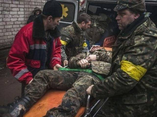 A file photo of a Ukrainian soldier being taken to medical facility. PHOTO: AFP