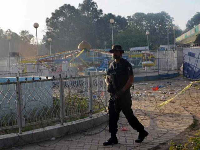 A police commando stands guard at the site following an overnight suicide bombing in Lahore on March 28, 2016. PHOTO: AFP