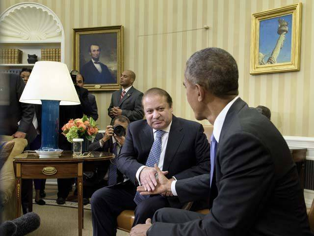 Prime Minister Nawaz Sharif and US President Barack Obama shake hands before a meeting in the Oval Office of the White House October 22, 2015 in Washington, DC. PHOTO : AFP