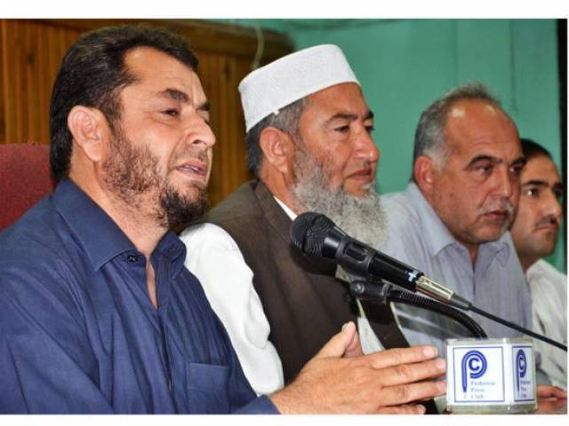 FATA Siyasi Ittehad President Iqbal Afridi addressing a news conference at Peshawar Press Club. PHOTO: ONLINE
