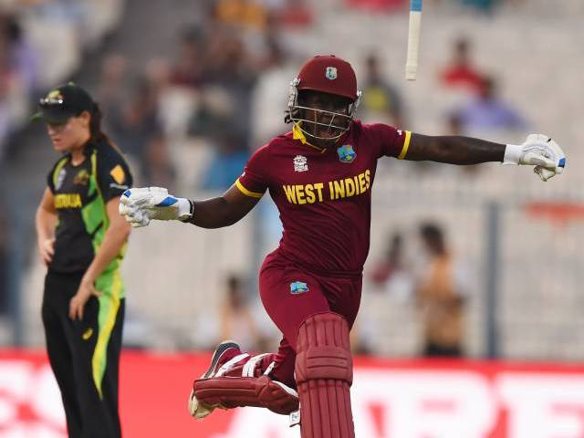 West Indies's Deandra Dottin celebrates after victory in the World T20 cricket tournament women's final match between Australia and West Indies at The Eden Gardens Cricket Stadium in Kolkata on April 3, 2016. PHOTO: AFP