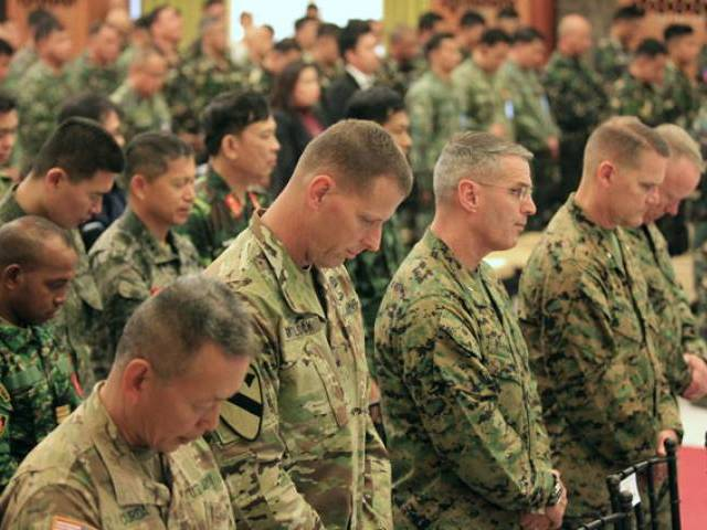 US troops pause in prayers during the opening ceremony of the 2016 Balikatan military exercises at the Armed Forces of the Philippines headquarters in Camp Aguinaldo, Quezon city, metro Manila April 4, 2016. PHOTO: REUTERS