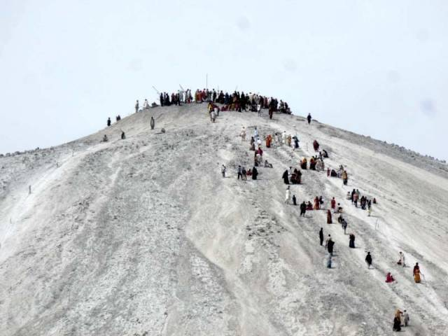 Pilgrims make their way to the top of Chandergup mud volcano in Hingol. PHOTO: ALI XAFAR/EXPRESS