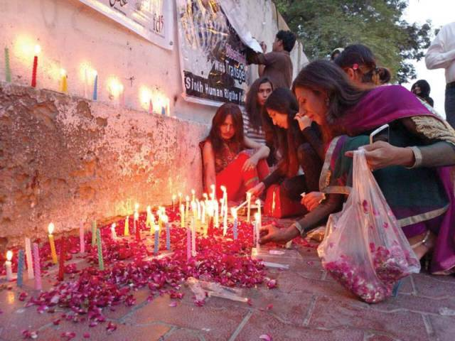 Around 25 transgender rights activists and supporters set up a candlelight vigil on a footpath outside the Karachi Press Club to mourn the death of Alisha, who died at a hospital in Peshawar after an alleged targeted attack. PHOTO: COURTESY KAMI CHAUDHRY
