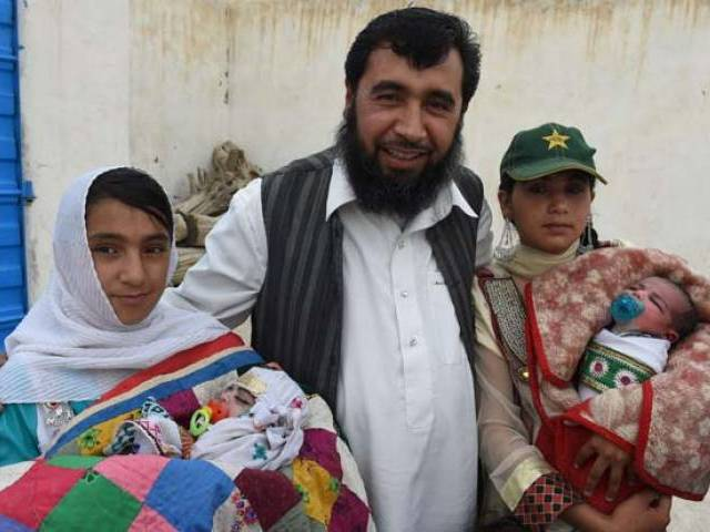 In this photograph taken on March 23, 2016, Pakistani father Sardar Haji Jan Mohammad Khilji poses with some of his children at his residence in Quetta. PHOTO: AFP