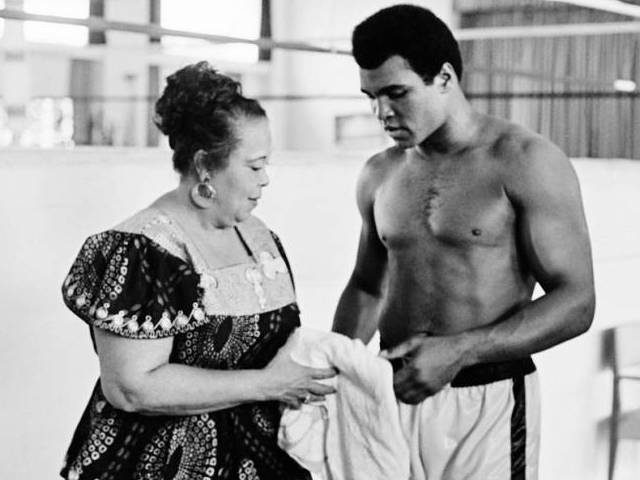 "This file photo taken on October 27, 1974 shows US boxing heavyweight champion Muhammad Ali (born Cassius Clay) standing with her mother Odessa Grady Clay during a training session three days before the heavy weight world championship in Kinshasa.  Boxing icon Muhammad Ali died on Friday, June 3, a family spokesman said in a statement. ""After a 32-year battle with Parkinson s disease, Muhammad Ali has passed away at the age of 74,"" spokesman Bob Gunnell said. PHOTO: AFP"