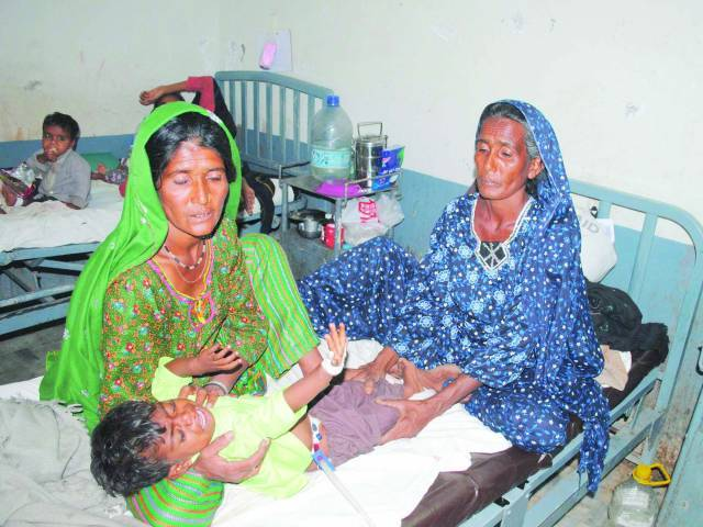 Women from Tharparkar attend a sick child in Civil Hospital, Hyderabad. PHOTO: FILE