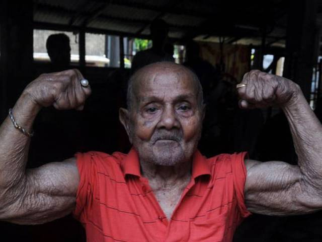 This file photo taken on March 16, 2012 shows Indian bodybuilder Manohar Aich at a gymnasium on the eve of his 100th birthday in Kolkata. PHOTO: AFP