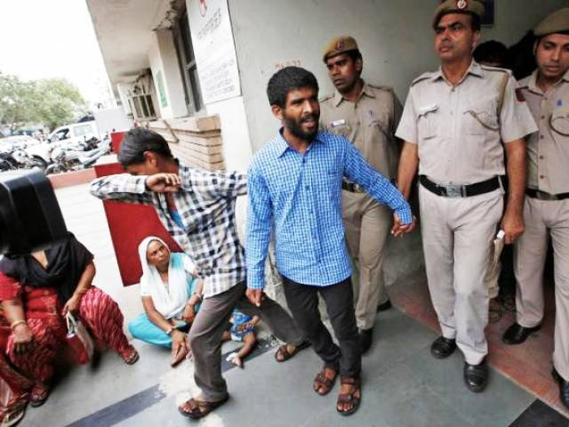 Policemen escort men convicted for the gang rape of a Danish woman, at a court in New Delhi, India, June 9, 2016. PHOTO: REUTERS