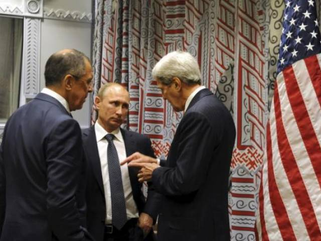 Russia's President Vladimir Putin (C), Foreign Minister Sergei Lavrov (L) and US Secretary of State John Kerry attend a meeting on the sidelines of the United Nations General Assembly in New York, September 28, 2015. PHOTO: REUTERS