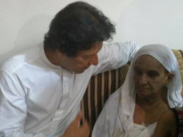 Imran Khan meets Amjad Sabri's mother in Karachi on Friday. PHOTO: PTI
