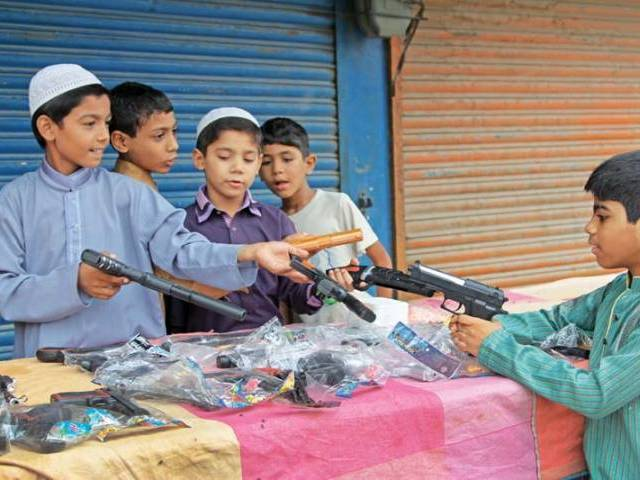 Activists warn of the negative effects of letting children play with guns. PHOTO: AYSHA SALEEM/EXPRESS