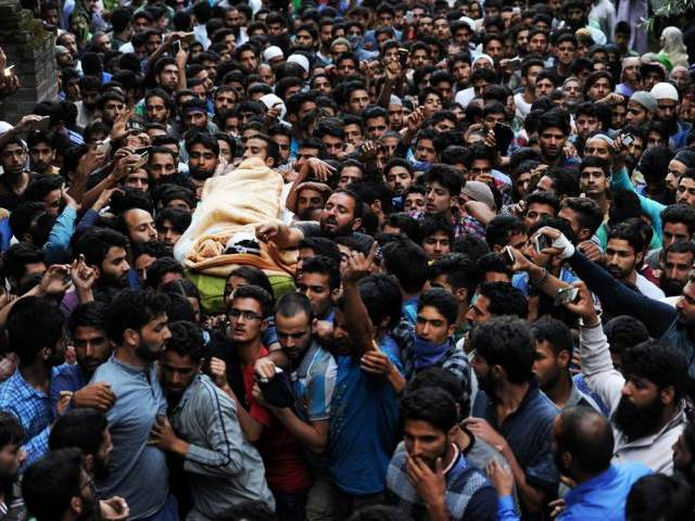 Kashmiri mourners carry the body of Burhan Muzaffar Wani, the new-age poster boy for the rebel movement in the restive Himalayan state of Jammu and Kashmir, ahead of his funeral in Tral, his native town, 42kms south of Srinagar on July 9, 2016.  PHOTO: AFP