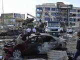 iraqi-security-forces-and-civilians-gather-at-the-site-of-a-car-bomb-attack-in-baghdad