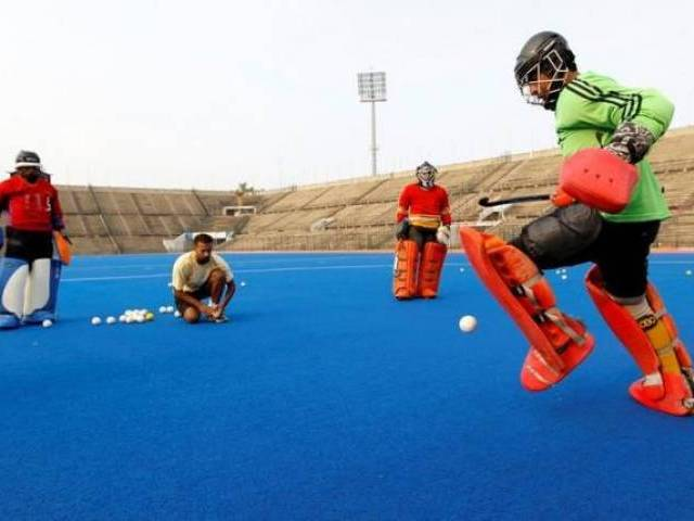 Hockey players train at the Gaddafi field hockey stadium in Lahore, Pakistan July 11, 2016. PHOTO: REUTERS