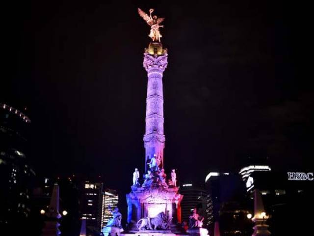 Mexican Independence Angel monument  is illuminated with the colors of the French national flag  on July 14, 2016 in Mexico City in solidarity following the deadly attack in Nice, France. PHOTO: AFP