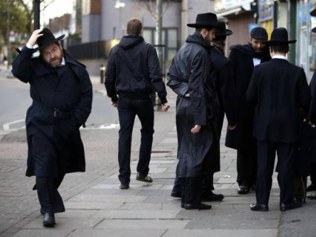 Jewish men talk in Golders Green, London, January 10, 2015. PHOTO: REUTERS
