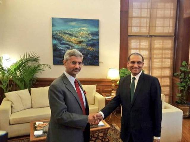 Foreign Secretary Aizaz Ahmed Chaudhry shakes hands with his Indian counterpart Subrahmanyam Jaishankar on Tuesday. PHOTO: MEA INDIA