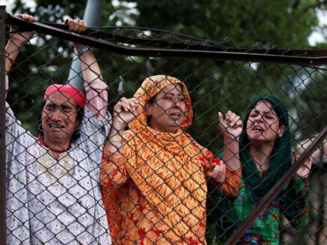 Kashmiri women mourn the death of Burhan Wani, during his funeral in Tral, south of Srinagar PHOTO: REUTERS