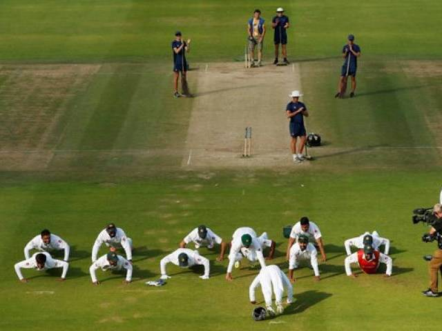 Pakistan's players perform press ups as they celebrate winning the first test against England at Lord's. PHOTO: REUTERS