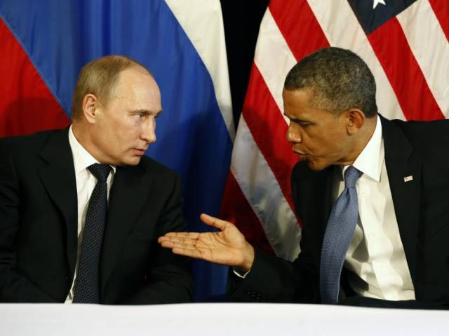 U.S. President Barack Obama and Russian President Vladimir Putin. PHOTO: REUTERS