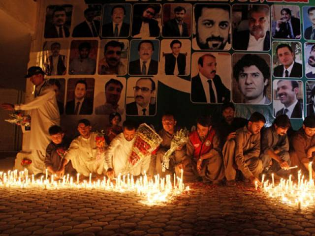 Residents light candles for lawyers killed during the Monday blast at Civil Hospital during a candle light vigil in Quetta, August 9, 2016. PHOTO: REUTERS