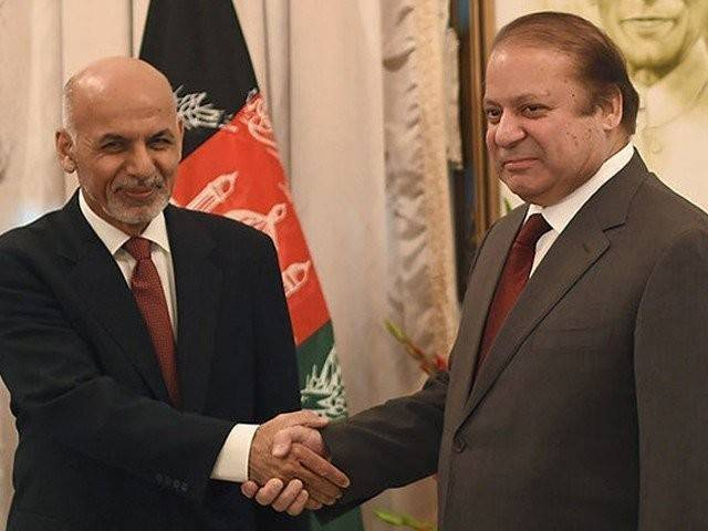 In this file photo, Prime Minister Nawaz Sharif shakes hands with Afghan President Ashraf Ghani. PHOTO: AFP