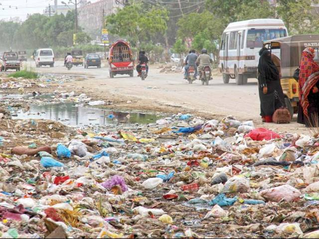 Apart from the daily traffic of students of six universities and residents of Malir, Saadi Town and Gulistan-e-Jauhar, overflowing gutters and leakage of waterlines leads to severe gridlocks every day. PHOTO: ATHAR KHAN/EXPRESS