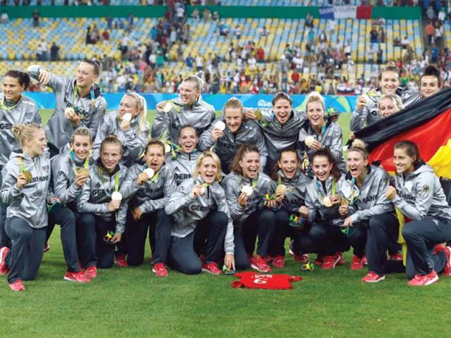 Germany's players pose with their first ever gold medals after their team's victory over Sweden during the Rio 2016 Olympic Games. PHOTO: AFP