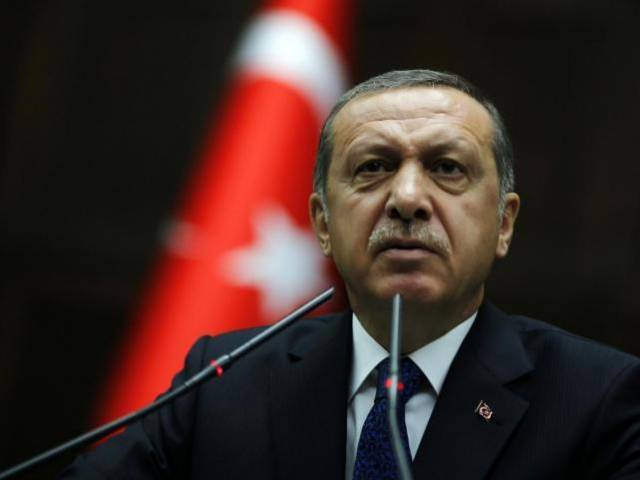 Turkey's Prime Minister Tayyip Erdogan addresses members of parliament from his ruling AK Party (AKP). PHOTO: REUTERS