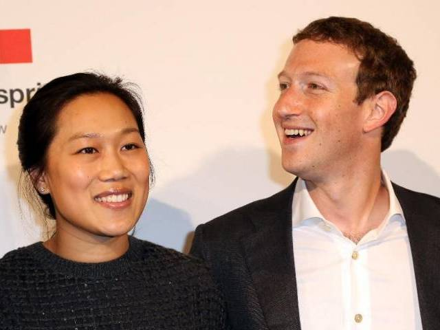 Priscilla Chan and Mark Zuckerberg. PHOTO: AFP