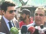 Express News screen grab of Faisal Vawda and Imran Ismael talking to media moments before the attack