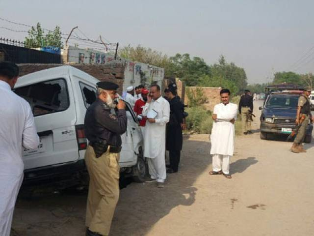 Investigators collect evidence from the sight of a targetted attack on security personnel in Gari Sohbat Khan area of Peshawar on Sunday. PHOTO: EXPRESS